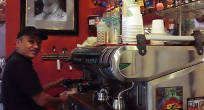 Truffle Shop Owner Rudy Udarbe prepares an Ice Cappucinno on a warm day.