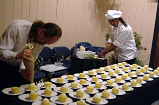 The Truffle Shop staff preparing gourmet desserts for a Music in the Mountains catering event.