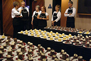A busy wait-staff ready to share gourmet chocolate dessert catering from the Truffle Shop in Nevada city, CA
