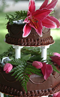 A closeup of  a gourmet chocolate truffle torte wedding cake created and catered by the Truffle Shop in Nevada City for a Hawaiian-themed wedding in Grass Valley, CA