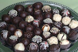 A closeup of a tray of gourmet chocolate truffles created and catered by the Truffle Shop in Nevada City for a Hawaiian-themed wedding in Grass Valley, CA